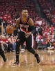 Apr 20, 2014; Houston, TX, USA; Portland Trail Blazers guard Damian Lillard (0) controls the ball during the first quarter /against the Houston Rockets in game one during the first round of the 2014 NBA Playoffs at Toyota Center. Mandatory Credit: Troy Taormina-USA TODAY Sports