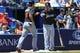 Apr 23, 2014; Atlanta, GA, USA; Miami Marlins catcher Jeff Mathis (6) celebrates scoring with third baseman Casey McGehee (9) in the sixth inning against the Atlanta Braves at Turner Field. Mandatory Credit: Daniel Shirey-USA TODAY Sports
