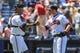 Apr 23, 2014; Atlanta, GA, USA; Atlanta Braves relief pitcher Craig Kimbrel (46) and catcher Gerald Laird (11) celebrate beating the Miami Marlins at Turner Field. The Braves won 3-1. Mandatory Credit: Daniel Shirey-USA TODAY Sports