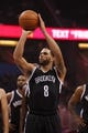 Apr 9, 2014; Orlando, FL, USA; Brooklyn Nets guard Deron Williams (8) shoots a free throw against the Orlando Magic during the first quarter at Amway Center. Mandatory Credit: Kim Klement-USA TODAY Sports