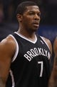 Apr 9, 2014; Orlando, FL, USA; Brooklyn Nets guard Joe Johnson (7) against the Orlando Magic during the first quarter at Amway Center. Mandatory Credit: Kim Klement-USA TODAY Sports