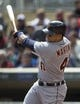 Apr 26, 2014; Minneapolis, MN, USA; Detroit Tigers designated hitter Victor Martinez (41) hits a RBI fly ball in the first inning against the Minnesota Twins at Target Field. Mandatory Credit: Jesse Johnson-USA TODAY Sports