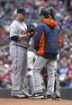 Apr 26, 2014; Minneapolis, MN, USA; Detroit Tigers pitching coach Jeff Jones talks to Detroit Tigers relief pitcher Phil Coke (40) in the fifth inning against the Minnesota Twins at Target Field. Mandatory Credit: Jesse Johnson-USA TODAY Sports