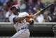 Apr 26, 2014; Minneapolis, MN, USA; Detroit Tigers right fielder Torii Hunter (48) hits a double in the sixth inning against the Minnesota Twins at Target Field. Mandatory Credit: Jesse Johnson-USA TODAY Sports