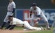 Apr 26, 2014; Minneapolis, MN, USA; Minnesota Twins right fielder Sam Fuld (1) slides into second base before Detroit Tigers shortstop Andrew Romine (27) can make a tag in the fifth inning at Target Field. Mandatory Credit: Jesse Johnson-USA TODAY Sports