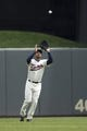 Apr 26, 2014; Minneapolis, MN, USA; Minnesota Twins center fielder Aaron Hicks (32) catches a fly ball in the fourth inning against the Detroit Tigers at Target Field. Mandatory Credit: Jesse Johnson-USA TODAY Sports