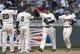 Apr 26, 2014; Minneapolis, MN, USA; Minnesota Twins left fielder Jason Kubel (13) celebrates with second baseman Brian Dozier (2) after beating the Detroit Tigers at Target Field. The Twins won 5-3. Mandatory Credit: Jesse Johnson-USA TODAY Sports