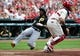 Apr 26, 2014; St. Louis, MO, USA; Pittsburgh Pirates center fielder Andrew McCutchen (22) slides safely into home plate past St. Louis Cardinals catcher Yadier Molina (4) during the fourth inning at Busch Stadium. Mandatory Credit: Jeff Curry-USA TODAY Sports