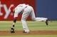Apr 26, 2014; Atlanta, GA, USA; Cincinnati Reds shortstop Zack Cozart (2) fields a ground ball against the Atlanta Braves in the first inning at Turner Field. Mandatory Credit: Brett Davis-USA TODAY Sports