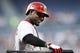 Apr 26, 2014; Atlanta, GA, USA; Cincinnati Reds second baseman Brandon Phillips (4) walks to the plate against the Atlanta Braves in the first inning at Turner Field. Mandatory Credit: Brett Davis-USA TODAY Sports