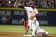 Apr 26, 2014; Atlanta, GA, USA; Cincinnati Reds second baseman Brandon Phillips (4) attempts to turn a double play against the Atlanta Braves in the sixth inning at Turner Field. Mandatory Credit: Brett Davis-USA TODAY Sports