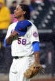 Apr 26, 2014; New York, NY, USA; New York Mets pitcher Jenrry Mejia (58) heads to the dugout after being relieved during the sixth inning against the Miami Marlins at Citi Field. Mandatory Credit: Anthony Gruppuso-USA TODAY Sports