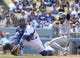 Apr 27, 2014; Los Angeles, CA, USA; Colorado Rockies center fielder Charlie Blackmon (19) slides into home to score beating a throw to Los Angeles Dodgers catcher Tim Federowicz (26) in the fifth inning at Dodger Stadium. Mandatory Credit: Robert Hanashiro-USA TODAY Sports