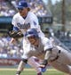 Apr 27, 2014; Los Angeles, CA, USA; Colorado Rockies right fielder Brandon Barnes (1) is tagged out by Los Angeles Dodgers second baseman Justin Turner (10) during a rundown between first and second in the fifth inning at Dodger Stadium. Mandatory Credit: Robert Hanashiro-USA TODAY Sports