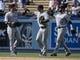 Apr 27, 2014; Los Angeles, CA, USA; Colorado Rockies left fielder Carlos Gonzalez (5) high-fives teammate right fielder Brandon Barnes (1) after the Rockies 6-1 win over the Los Angeles Dodgers at Dodger Stadium. Mandatory Credit: Robert Hanashiro-USA TODAY Sports