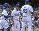 Apr 27, 2014; Los Angeles, CA, USA; Los Angeles Dodgers manager Don Mattingly (8) heads to the pitchers mound to remove starting pitcher Hyun-Jin Ryu (99) in the 6th inning at Dodger Stadium. Mandatory Credit: Robert Hanashiro-USA TODAY Sports