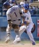 Apr 27, 2014; Los Angeles, CA, USA; Colorado Rockies right fielder Brandon Barnes (1) slides into second base ahead of the tag by Los Angeles Dodgers shortstop Justin Turner (10) in the 9th inning at Dodger Stadium. Mandatory Credit: Robert Hanashiro-USA TODAY Sports