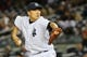 Apr 27, 2014; Bronx, NY, USA;  New York Yankees starting pitcher Masahiro Tanaka (19) works during the first inning against the Los Angeles Angels at Yankee Stadium. Mandatory Credit: Anthony Gruppuso-USA TODAY Sports