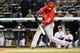 Apr 27, 2014; Bronx, NY, USA;  Los Angeles Angels shortstop Erick Aybar (2) doubles to right during the fourth inning against the New York Yankees at Yankee Stadium. Mandatory Credit: Anthony Gruppuso-USA TODAY Sports