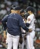 Apr 29, 2014; Houston, TX, USA; Houston Astros pitching coach Brent Strom (53) talks with starting pitcher Jarred Cosart (48) during the sixth inning against the Washington Nationals at Minute Maid Park. Mandatory Credit: Troy Taormina-USA TODAY Sports