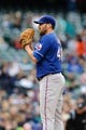 Apr 26, 2014; Seattle, WA, USA; Texas Rangers starting pitcher Colby Lewis (48) during the game against the Seattle Mariners at Safeco Field. Texas defeated Seattle 6-3. Mandatory Credit: Steven Bisig-USA TODAY Sports