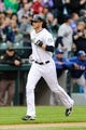 Apr 26, 2014; Seattle, WA, USA; Seattle Mariners right fielder Michael Saunders (55) scores a run on a solo home run against the Texas Rangers during the game at Safeco Field. Texas defeated Seattle 6-3. Mandatory Credit: Steven Bisig-USA TODAY Sports