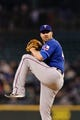Apr 26, 2014; Seattle, WA, USA;Texas Rangers starting pitcher Colby Lewis (48) pitches to the Seattle Mariners at Safeco Field. Texas defeated Seattle 6-3. Mandatory Credit: Steven Bisig-USA TODAY Sports