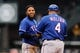 Apr 26, 2014; Seattle, WA, USA; Texas Rangers shortstop Elvis Andrus (1) and Texas Rangers first base coach Bengie Molina (4) during the game against the Seattle Mariners at Safeco Field. Texas defeated Seattle 6-3. Mandatory Credit: Steven Bisig-USA TODAY Sports