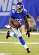 Aug 18, 2013; East Rutherford, NJ, USA; New York Giants cornerback Jayron Hosley (28) returns an interception during the first half against the Indianapolis Colts at MetLife Stadium. Mandatory Credit: Jim O'Connor-USA TODAY Sports