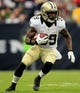 Aug 25, 2013; Houston, TX, USA; New Orleans Saints running back Travaris Cadet (39) rushes against the Houston Texans during the second half at Reliant Stadium. The Saints won 31-23. Mandatory Credit: Thomas Campbell-USA TODAY Sports