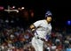 Apr 30, 2014; Phoenix, AZ, USA; Colorado Rockies outfielder Carlos Gonzalez tosses his bat after being walked against the Arizona Diamondbacks at Chase Field. Mandatory Credit: Mark J. Rebilas-USA TODAY Sports