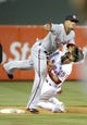 May 2, 2014; Philadelphia, PA, USA; Philadelphia Phillies catcher Carlos Ruiz (51) tries to break up double play against Washington Nationals shortstop Ian Desmond (20) in the ninth inning at Citizens Bank Park. The Nationals defeated the Phillies, 5-3. Mandatory Credit: Eric Hartline-USA TODAY Sports