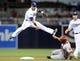 May 2, 2014; San Diego, CA, USA; San Diego Padres shortstop Everth Cabrera (2) jumps to avoid contact with Arizona Diamondbacks third baseman Martin Prado (14) a double play during the eighth inning at Petco Park. Mandatory Credit: Christopher Hanewinckel-USA TODAY Sports