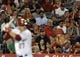 May 2, 2014; Anaheim, CA, USA; A Los Angeles Angels fan holds up a cutout head of Los Angeles Angels center fielder Mike Trout (left) during his at-bat against the Texas Rangers during the seventh inning at Angel Stadium of Anaheim. Mandatory Credit: Kelvin Kuo-USA TODAY Sports