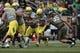 May 3, 2014; Eugene, OR, USA; Oregon Ducks running back Kani Benoit (36) runs the ball as Oregon Ducks Linebacker Joe Walker (35) closes the gap at Autzen Stadium. Mandatory Credit: Scott Olmos-USA TODAY Sports