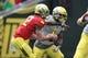May 3, 2014; Eugene, OR, USA; Oregon Ducks quarterback Taylor Alie (12) hands the ball off to Oregon Ducks running back byron Marshall (9) at Autzen Stadium. Mandatory Credit: Scott Olmos-USA TODAY Sports