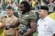 May 3, 2014; Eugene, OR, USA; Oregon Ducks defensive end Christian French (96) stands with US military personnel before the Spring Game at Autzen Stadium. Mandatory Credit: Scott Olmos-USA TODAY Sports
