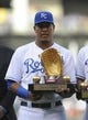 May 3, 2014; Kansas City, MO, USA;  Kansas City Royals catcher Salvador Perez (13) holds his Golden Glove award before the game against the Detroit Tigers at Kauffman Stadium. Detroit won 9-2. Mandatory Credit: John Rieger-USA TODAY Sports