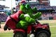May 4, 2014; Philadelphia, PA, USA; The Phillies Phanatic gives his Mom Phobee a ride around the diamond during Mom's appreciation day  in a game between the Phillies and against the Washington Nationals at Citizens Bank Park. Mandatory Credit: Bill Streicher-USA TODAY Sports