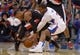 Feb 12, 2014; Los Angeles, CA, USA; Portland Trail Blazers guard Damian Lillard (0) and Los Angeles Clippers guard Chris Paul (3) battle for the ball in the fourth quarter at Staples Center. The Clippers defeated the Trail Blazers 122-117. Mandatory Credit: Kirby Lee-USA TODAY Sports
