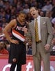 Feb 12, 2014; Los Angeles, CA, USA; Portland Trail Blazers coach Terry Stotts (right) and guard C.J. McCollum (3) during the game against the Los Angeles Clippers at Staples Center. Mandatory Credit: Kirby Lee-USA TODAY Sports