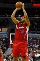 Dec 14, 2013; Washington, DC, USA; Los Angeles Clippers small forward Jared Dudley (9) shoots the ball against the Washington Wizards at Verizon Center. Mandatory Credit: Geoff Burke-USA TODAY Sports