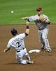 May 5, 2014; Milwaukee, WI, USA; Arizona Diamondbacks second baseman Aaron Hill (2) turns a double play after forcing out Milwaukee Brewers second baseman Scooter Gennett (2) in the first inning at Miller Park. Mandatory Credit: Benny Sieu-USA TODAY Sports