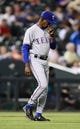 May 5, 2014; Denver, CO, USA; Texas Rangers manager Ron Washington (38) walks out to the mound in the eighth inning against the Colorado Rockies at Coors Field. The Rockies defeated the Rangers 8-2. Mandatory Credit: Ron Chenoy-USA TODAY Sports