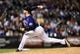 May 5, 2014; Denver, CO, USA; Colorado Rockies starting pitcher Jordan Lyles (24) throws in the ninth inning against the Texas Rangers at Coors Field. The Rockies defeated the Rangers 8-2. Mandatory Credit: Ron Chenoy-USA TODAY Sports