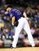 May 5, 2014; Denver, CO, USA; Colorado Rockies relief pitcher Nick Masset (37) prepares to throw in the ninth inning against the Texas Rangers at Coors Field. The Rockies defeated the Rangers 8-2. Mandatory Credit: Ron Chenoy-USA TODAY Sports