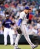 May 5, 2014; Denver, CO, USA; Texas Rangers starting pitcher Martin Perez (33) reacts after giving up a run in the third inning against the Colorado Rockies at Coors Field. Mandatory Credit: Ron Chenoy-USA TODAY Sports