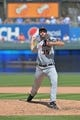 May 4, 2014; Kansas City, MO, USA; Detroit Tigers pitcher Justin Verlander (35) delivers a warm up pitch against the Kansas City Royals during the sixth inning at Kauffman Stadium. Mandatory Credit: Peter G. Aiken-USA TODAY Sports