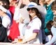 May 4, 2014; Philadelphia, PA, USA; A Philadelphia Phillies fan wearing a free derby hat smiles during a game against the Washington Nationals at Citizens Bank Park. The Phillies defeated the Nationals 1-0.  Mandatory Credit: Bill Streicher-USA TODAY Sports