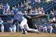 May 4, 2014; Kansas City, MO, USA; Kansas City Royals second basemen Omar Infante (14) singles against the Detroit Tigers during the ninth inning at Kauffman Stadium. Mandatory Credit: Peter G. Aiken-USA TODAY Sports